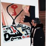 """Ritratto (portrait). Omaggio al""""Cantore infinito delle chiavi"""" Pio Mastrogiacomo. Sullo sfondo il ritratto di Joan Mirò. 2016 olio su tela cm 35x50. Pasquale Mastrogiacomo, Acerno (SA)."""